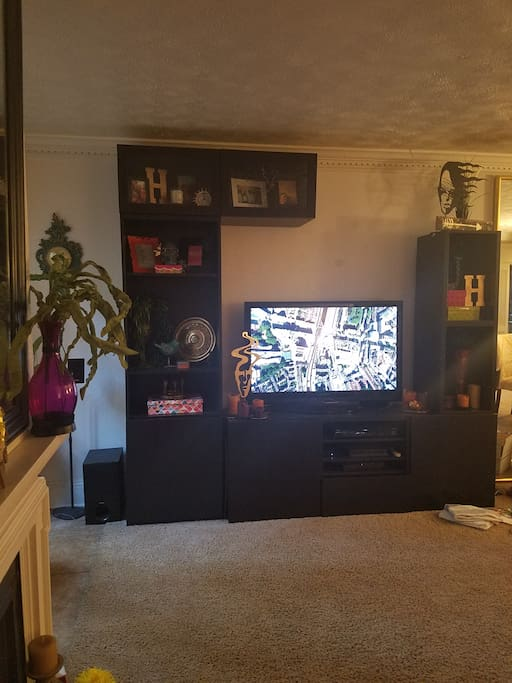spacious living with TV and entertainment center