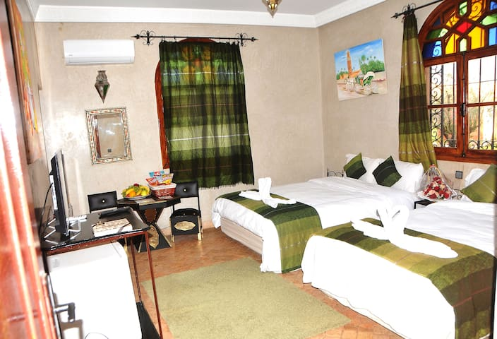 Triple Room with private bathroom TV and sitting area