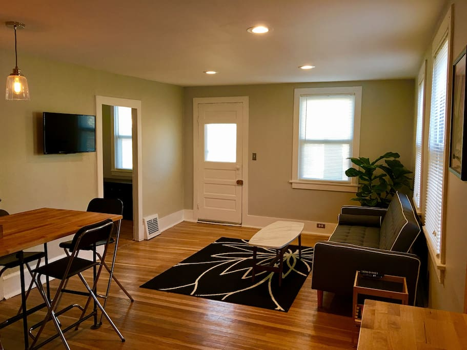 Living room with hardwood floors, natural light & views of the Terminal Tower!
