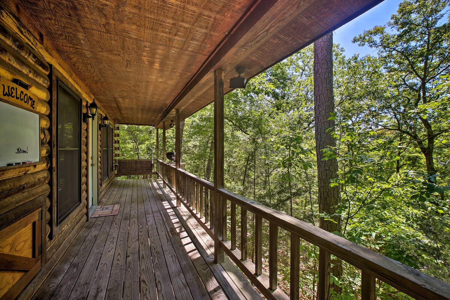Perfect for couples, this studio cabin offers a grill, views & bench swing!
