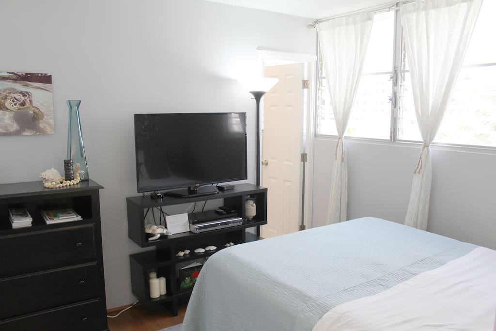 Guest bedroom with large TV equipped with cable!