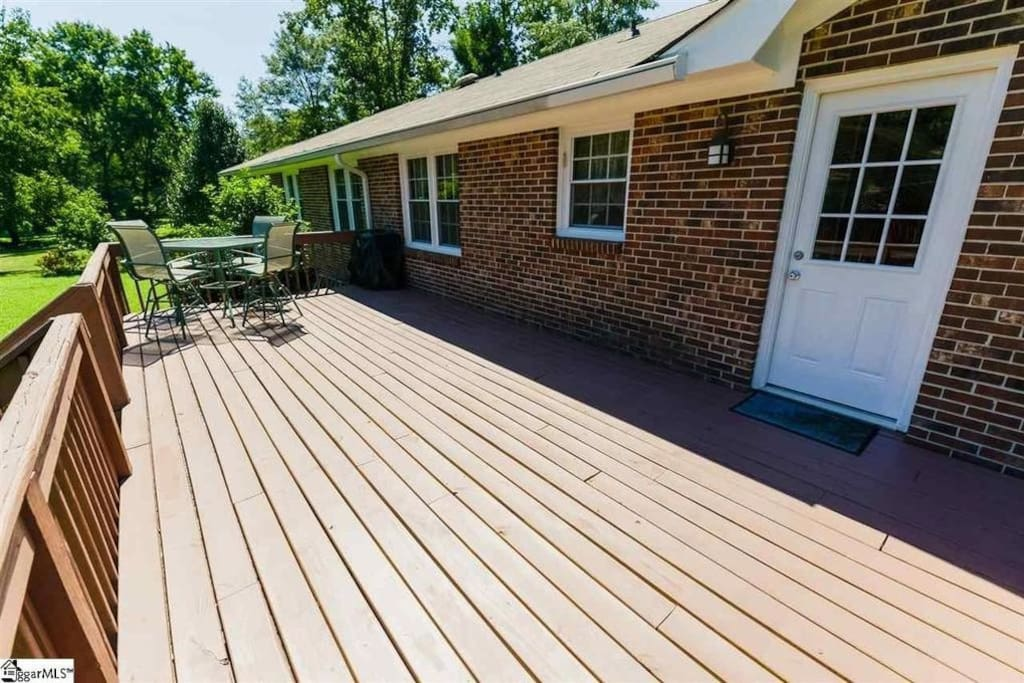Back Deck with Privacy Fence and Table/Chair set and Fire pit