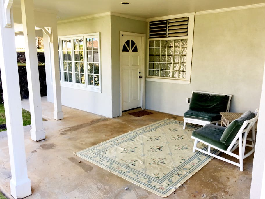Covered lanai to relax outside and entrance to the studio unit.