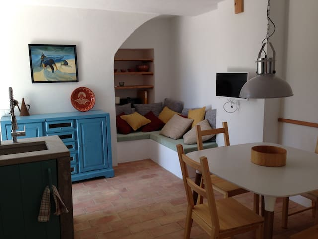 The cosy living room and fully equipped kitchen.