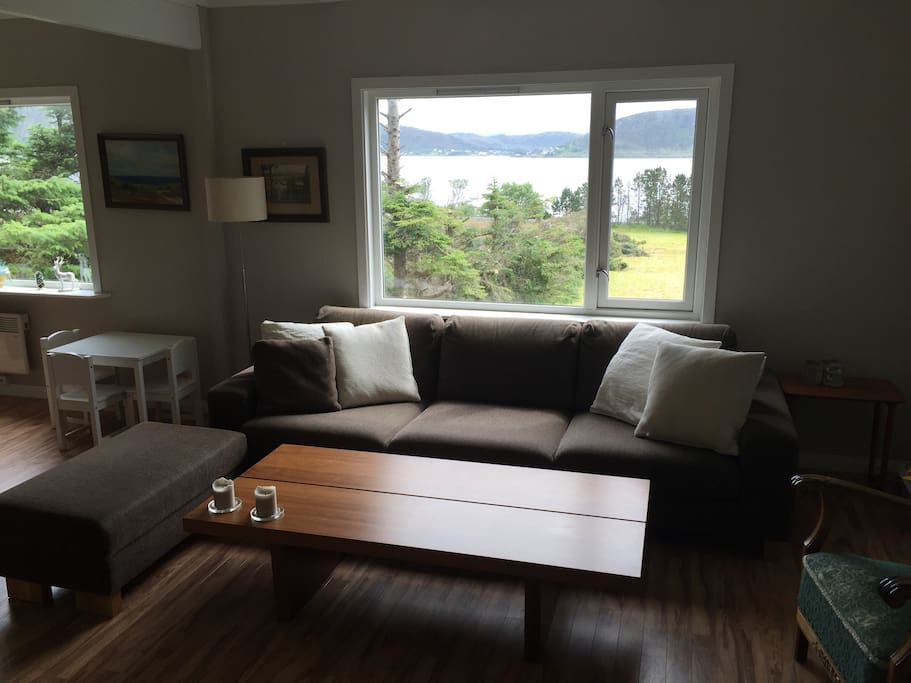 Very comfy sofa in spacious living/dining room with great views from all windows