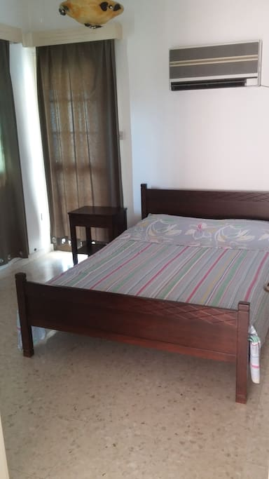 Main bedroom with double bed with access to a small kitchen balcony