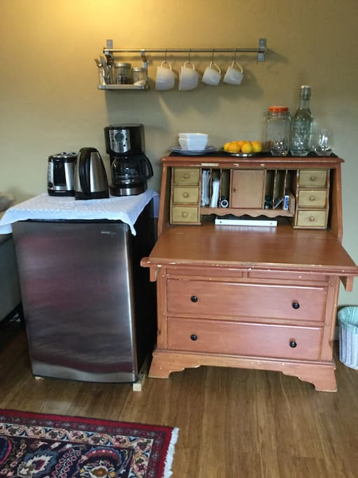 The refrigerator and desk contain all you need for coffee, tea and a light breakfast. The desk can also be a work space.