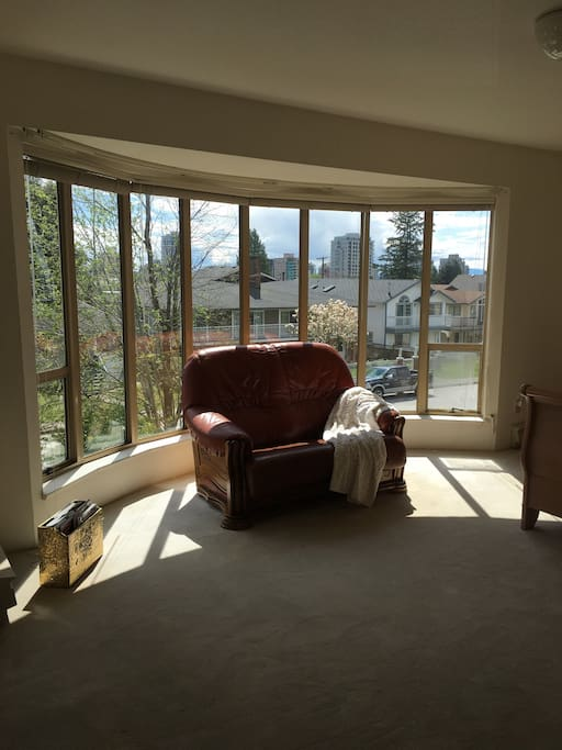Enjoy sitting in the sun with the floor to ceiling windows