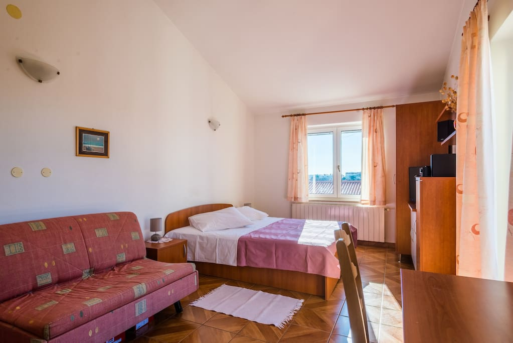 Studio with double bed and a sofa-bed.