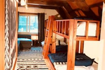 Lodge-style bunk room with 2 sets of twin over full bunks, a full sofa bed & 6 lockers for organizing gear