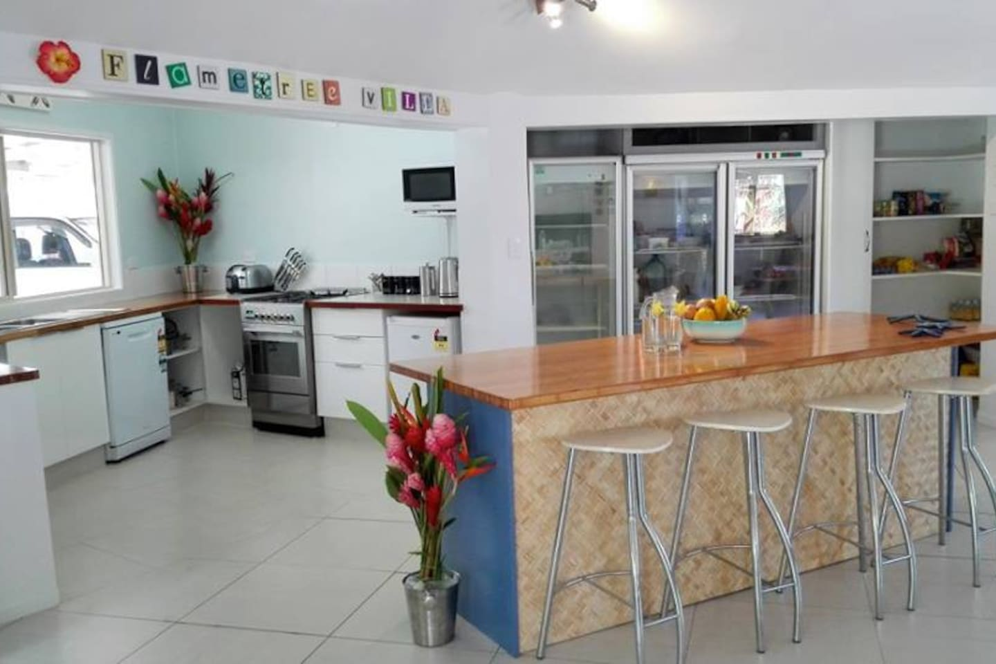 A spacious open plan kitchen with many appliances!