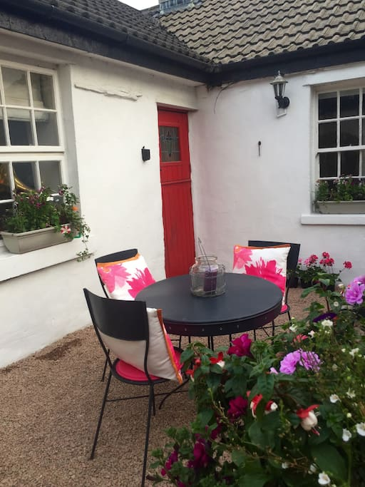 Delightful courtyard garden - a lovely sheltered and cosy spot when the sun shines!