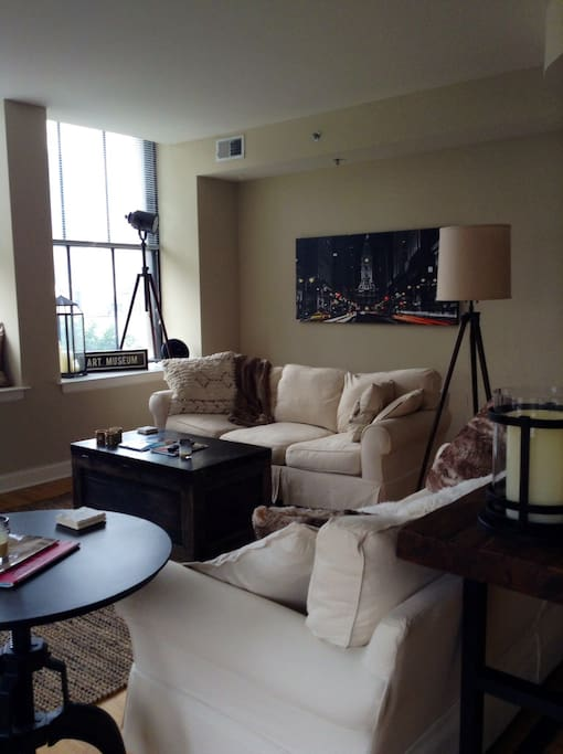 Living room, which features two full-size sofas, a big-screen television and beautiful decor