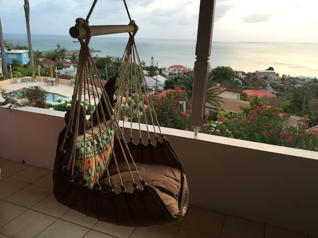 Relax on the patio in the hammock swing.