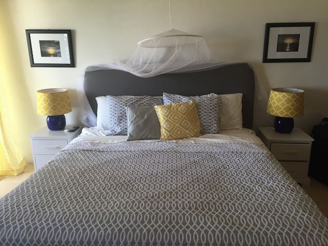 Sleep well in this large bed with optional mosquito netting.
