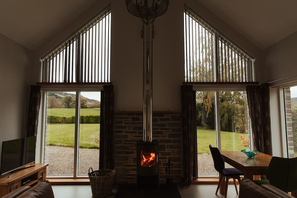 Open plan living area with wood burning stove.