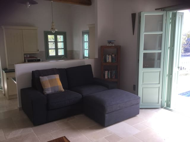 Twin sofa , open plan area with kitchen behind