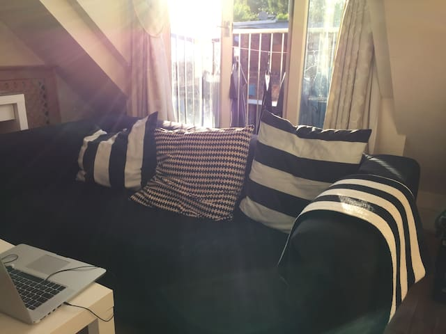 Comfortable Sofa and cushions in the afternoon sun