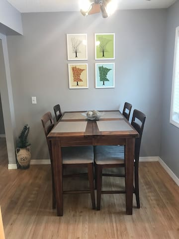 Dinning room for 4. There is a leaf insert and extra stool in the basement