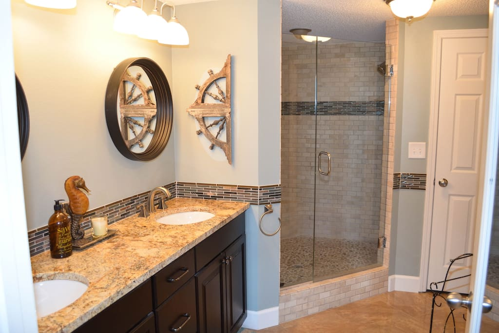 Master bathroom with walk-in shower and nice walk-in closet