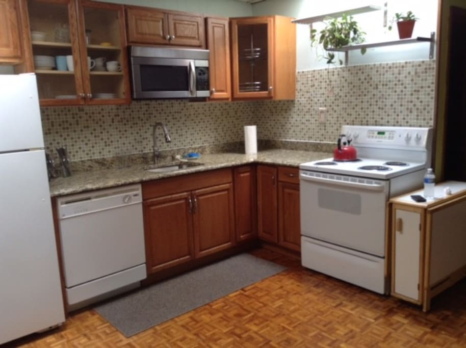 Upgraded kitchen with dishwasher, granite countertops, stainless sink, electric stove.