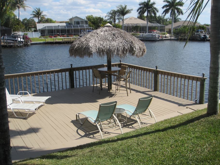 Chill out on the deck with tiki and bar chairs, chaises, porch chairs, and plenty of room.   Manatees and dolphins often swim by, and there's also fishing gear.