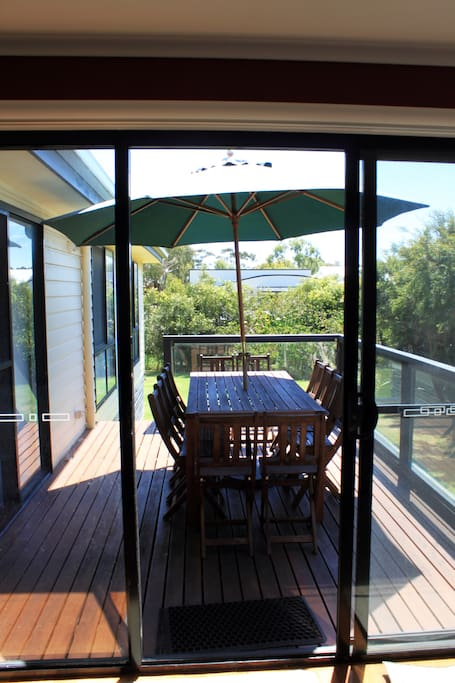 Sun covered deck overlooking the garden. 4 burner BBQ available.