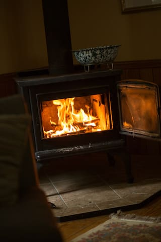 Wood stove going on chilly rainy or snowy days and romantic nights