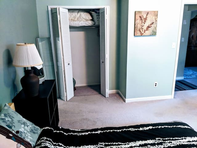 Plenty of closet space with extra bedding, clothes hangers, luggage rack, space heater, etc.