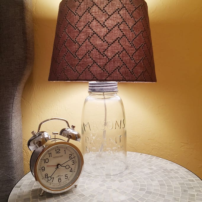 A reading light is on each side of the bed.