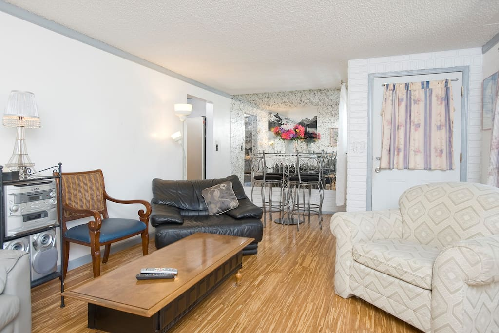 Bright & Cozy living room with large comfy chairs. Flatscreen TV & DVD player too!