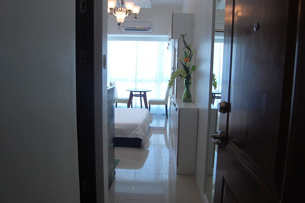 view of unit from outside. Equipped with chandelier & various lightings