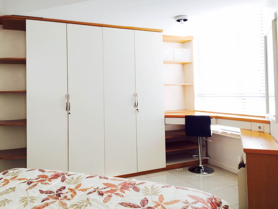 Main bedroom includes a King bed, wardrobe and working corner