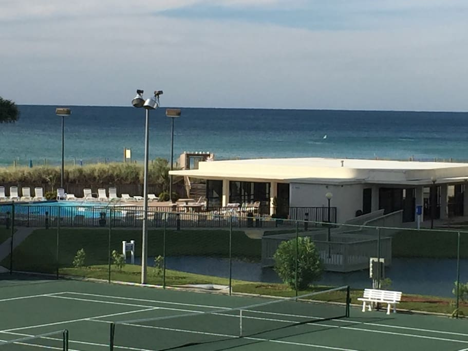 View from the balcony of the tennis courts, pool, pond, clubhouse and ocean!!