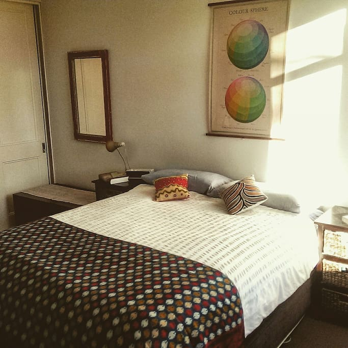 Large main bedroom with queen bed