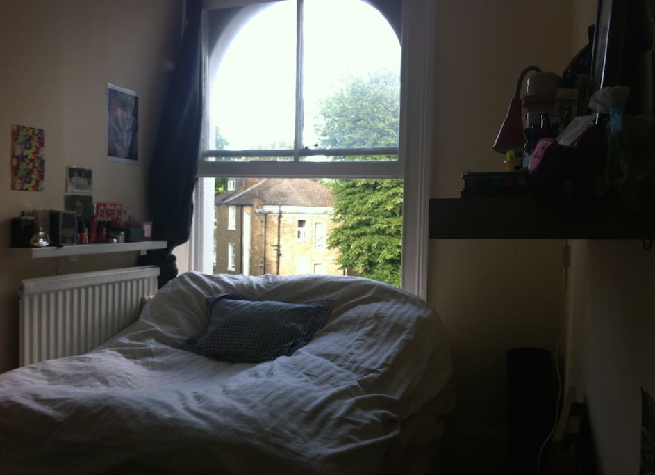 The room: a large window allows a lot of light in