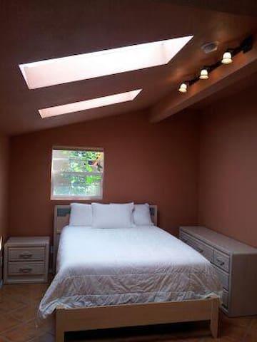 Main bedroom, queen sized bed, Silk cover, skylights (opaque).