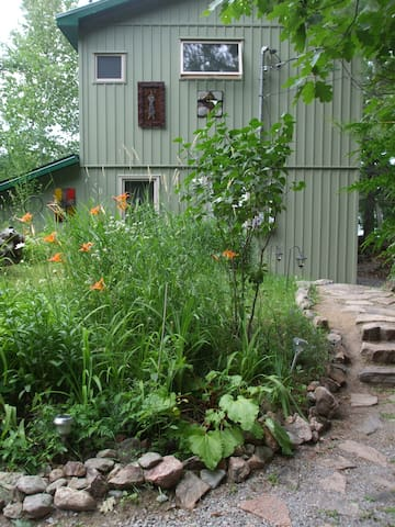 Entrance to main cottage - steps from guest cabin.