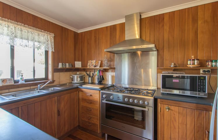 Fully self-contained kitchen with large double stainless steel oven & microwave
