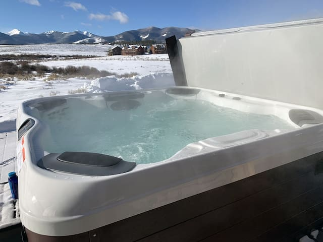 New common area hot tub with views of Winter Park Resort
