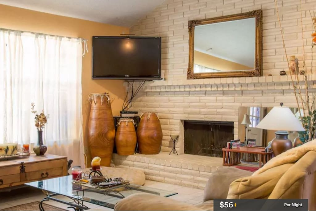 Big Screen Television and Wooden Fireplace