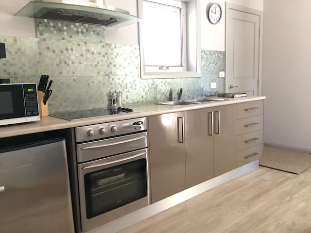 Feel free to cook up a storm in the kitchen or just serve up that takeaway! coffee machine & pods, kettle, sandwich maker, microwave, oven, grill and fridge with small freezer section.