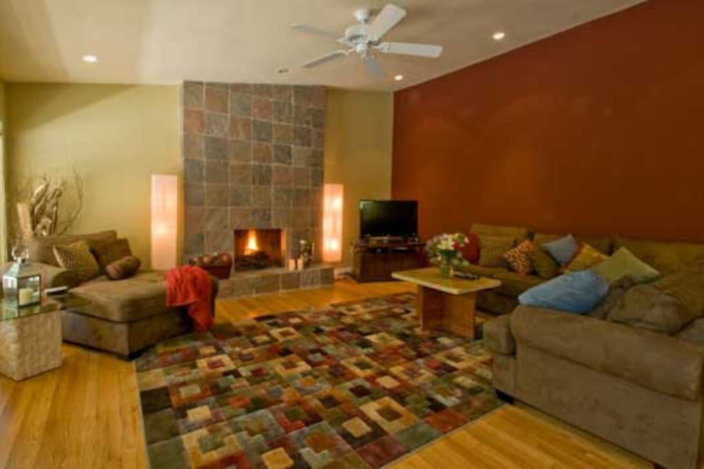 Large living room with slate  fireplace, cable TV with DVD, wi fi, celing fan for warm summer days
