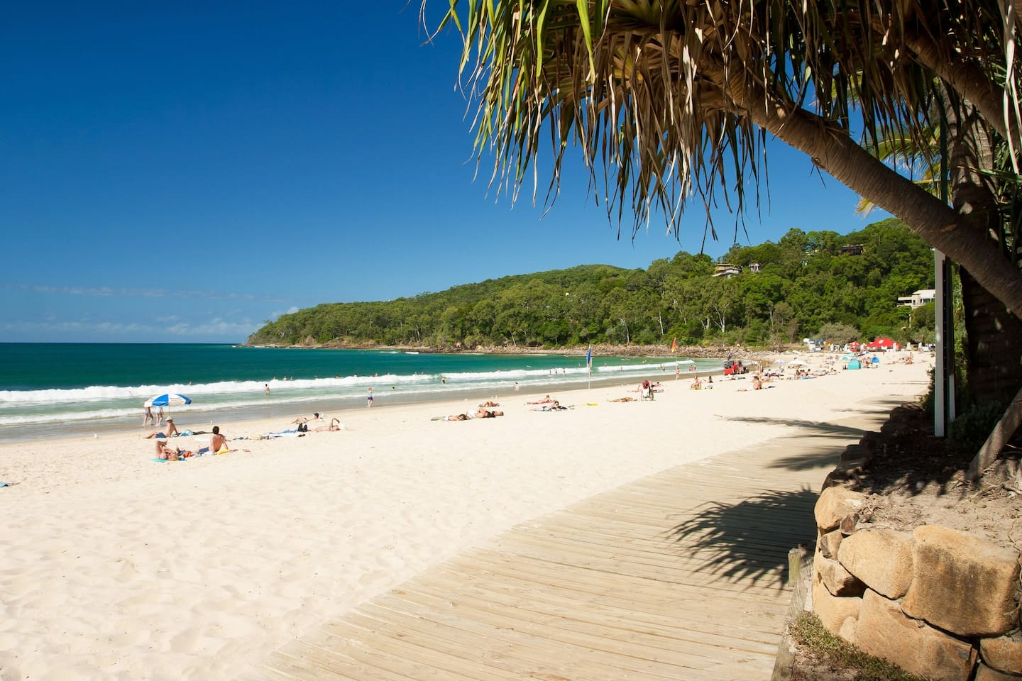 Noosa Main Beach Boardwalk. Backs onto Hasting Street, lots of great restaurants and bars