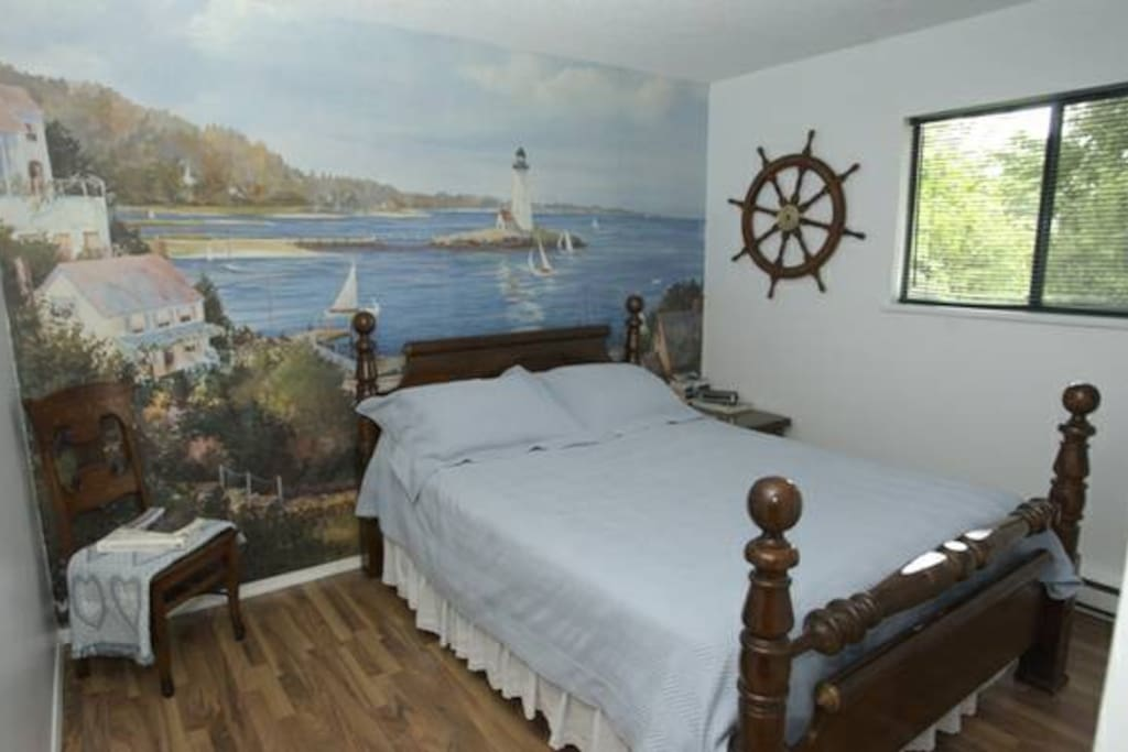 A nautical mural, beachside accents and a comfy queen bed in one of the three bedrooms.