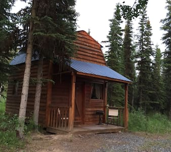 Alpine Heather cabin in the woods