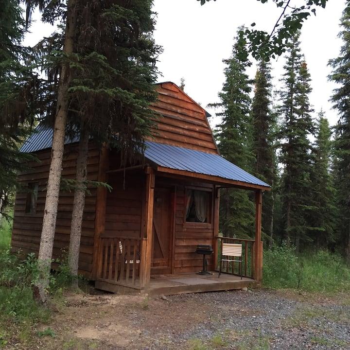 Alpine Heather cabin in the woods
