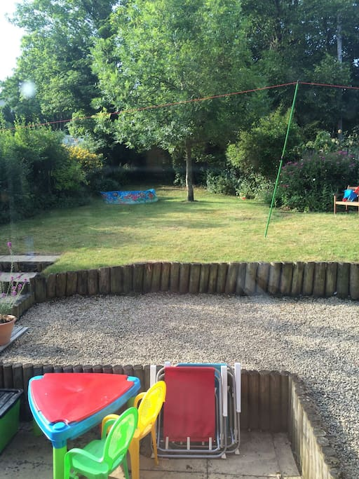 South facing garden with paddling pool and childrens toys