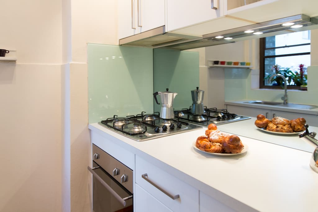 Fully equipped kitchen with gas oven and stove top