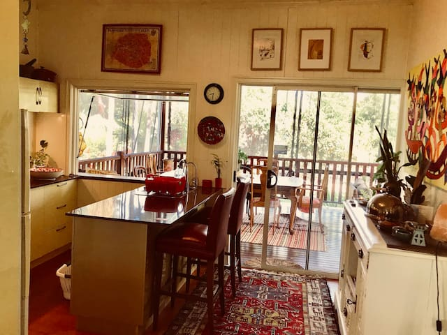 Open plan kitchen opens onto large back deck